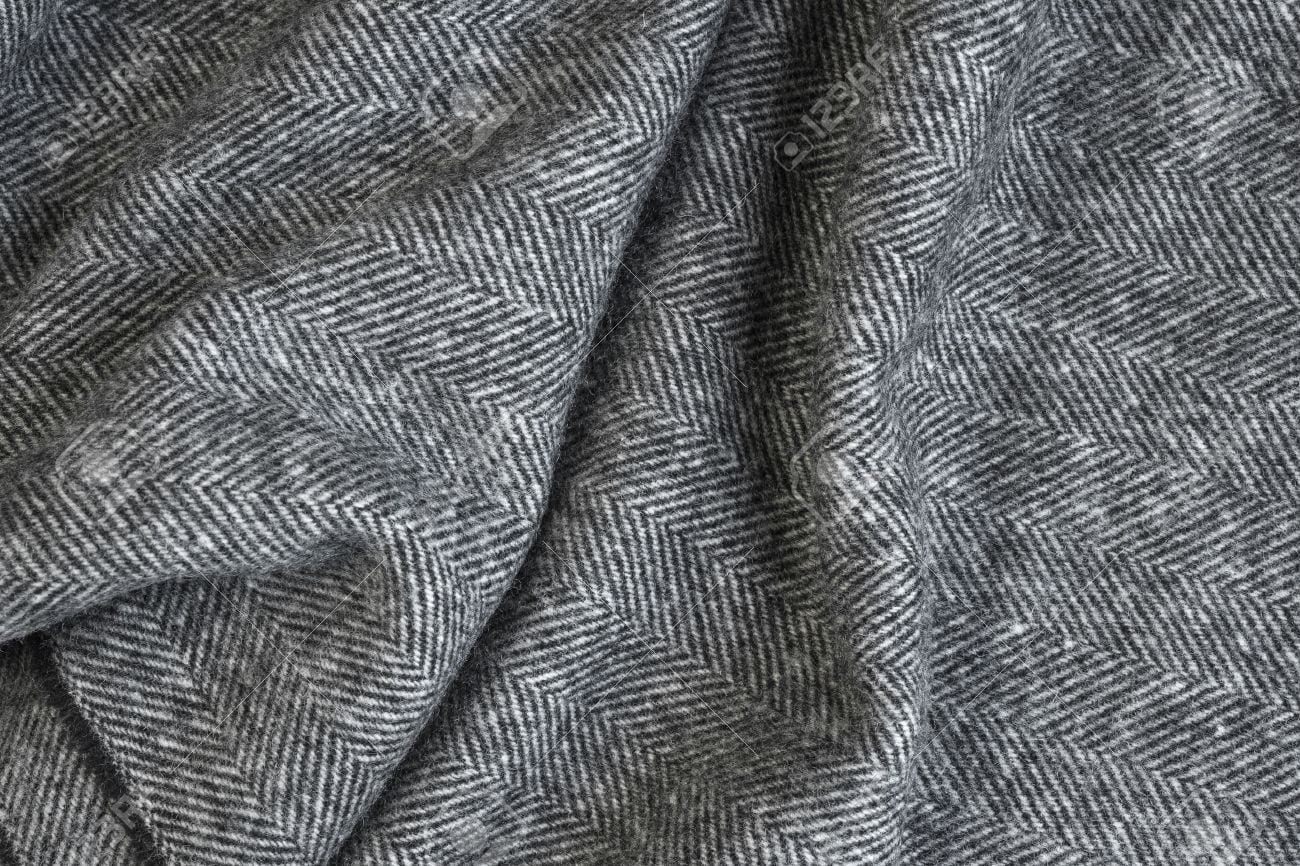 45327264-draped-herringbone-tweed-background-with-closeup-on-wool-fabric-texture